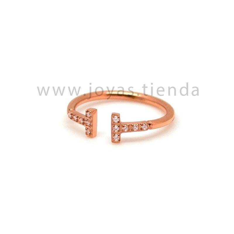 Anillo abiero básico con circonitas acero chapado color rosa
